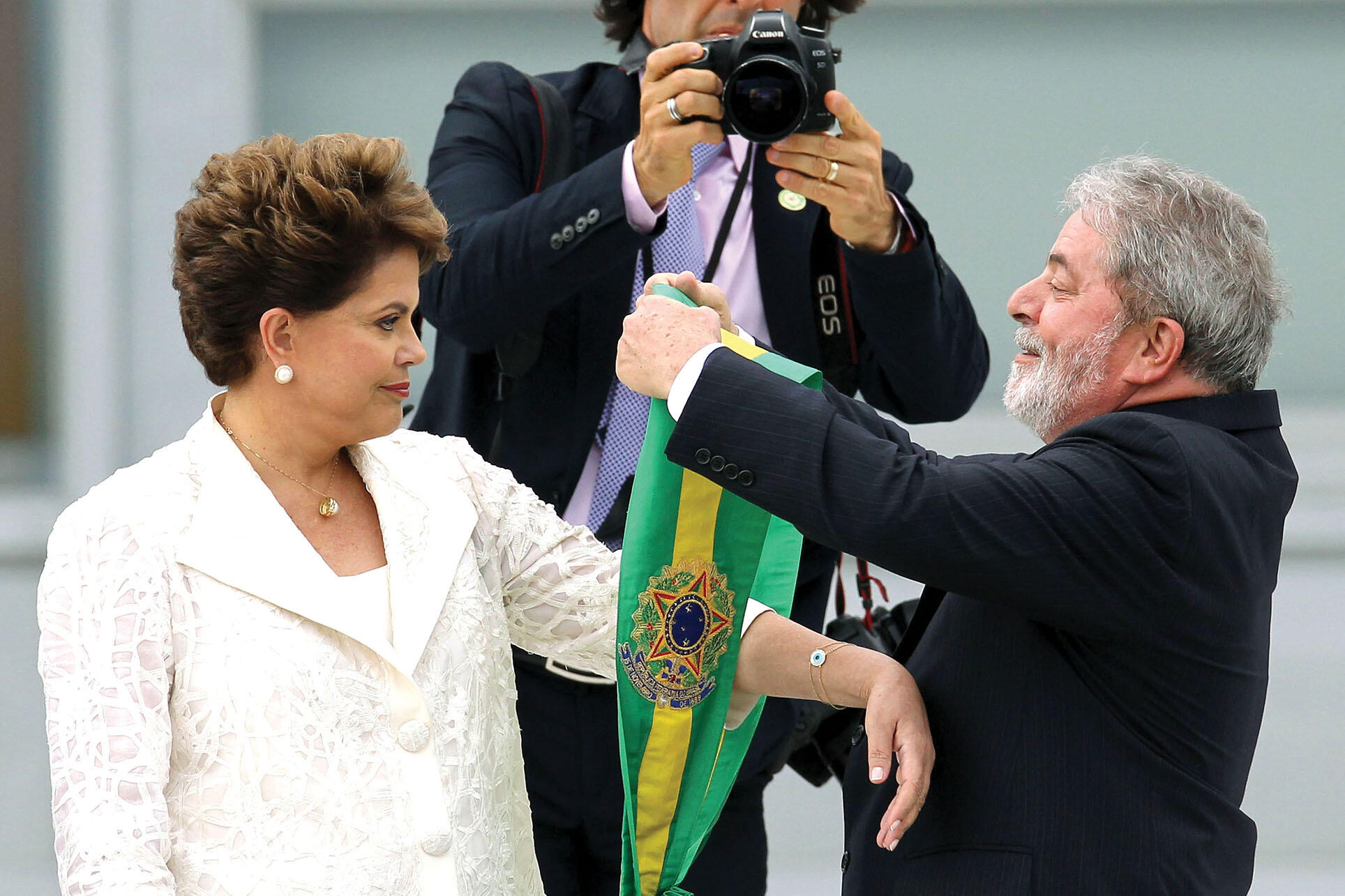 Lula hands over the presidential sash to Dilma Rousseff for her inauguration in 2011. (Photo by Celso Junior/Agência Estado/AE.)