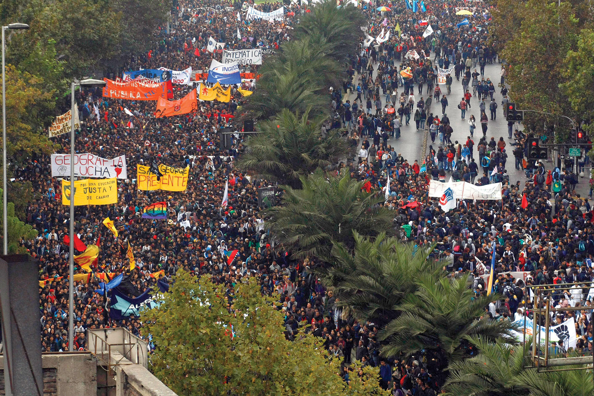 Differences over educational policy led students to Chile's streets again in 2013. (Photo by Luis Hidalgo/AP Photo.)