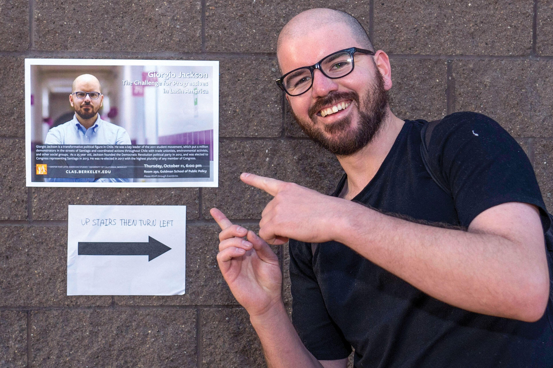 Giorgio Jackson with a poster advertising his talk at Berkeley, October 2018. (Photo by Jim Block.)