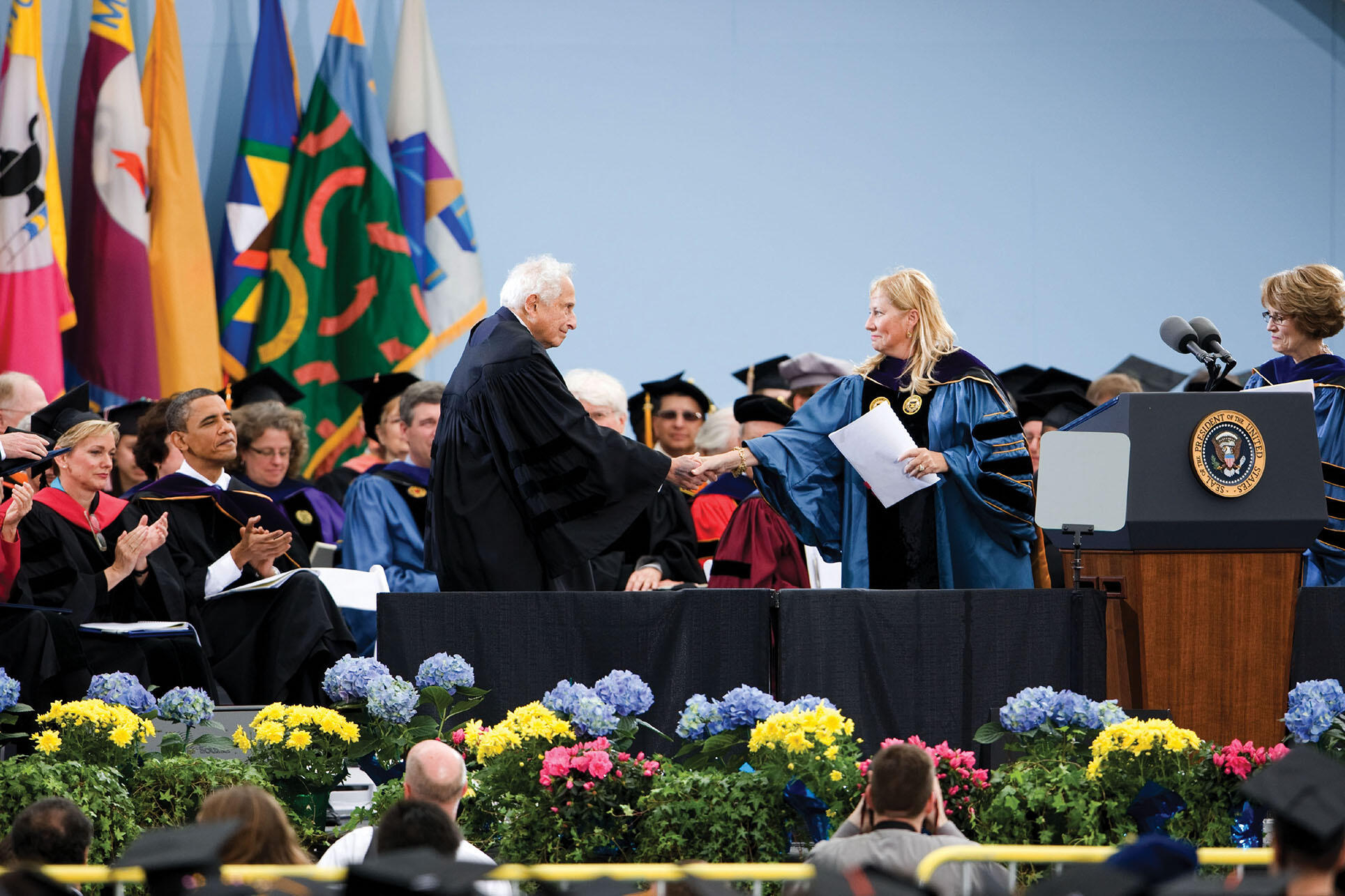 Stan Ovshinsky receives an honorary Doctor of Science degree from the University of Michigan, Ann Arbor, in 2010. At left, Michigan Governor Jennifer Granholm and President Barack Obama applaud. (Photo by Scott C. Soderberg/Michigan Photography.)