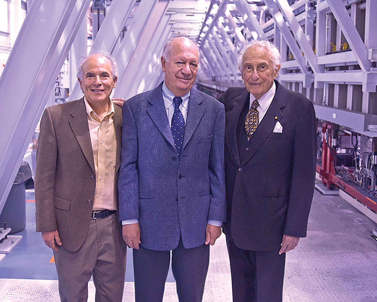 Stan Ovshinsky hosting Harley Shaiken and Ricardo Lagos at one of his continuous thin-film solar production machines in Detroit in 2009. (Photo by Brendan Ross.)