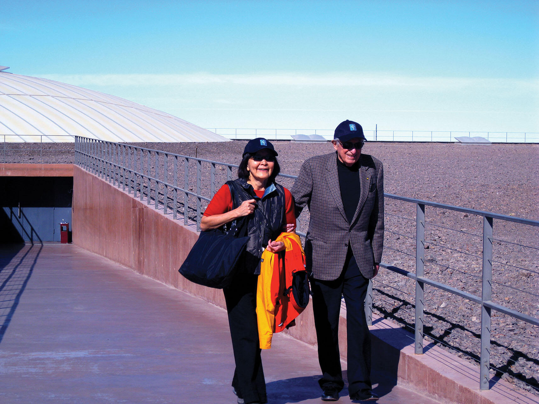 Stan and Rosa Ovshinsky outside the domes at the Paranal Observatory in Chile's Atacama Desert, 2009. (Photo by Beatriz Manz.)