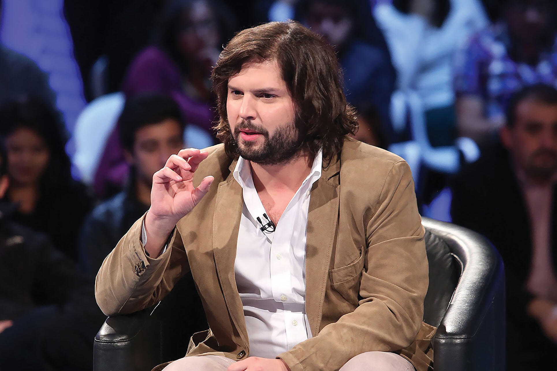 Gabriel Boric being interviewed as a candidate for Chile's Congress, April 2013. (Photo courtesy of Fotos TVN.)