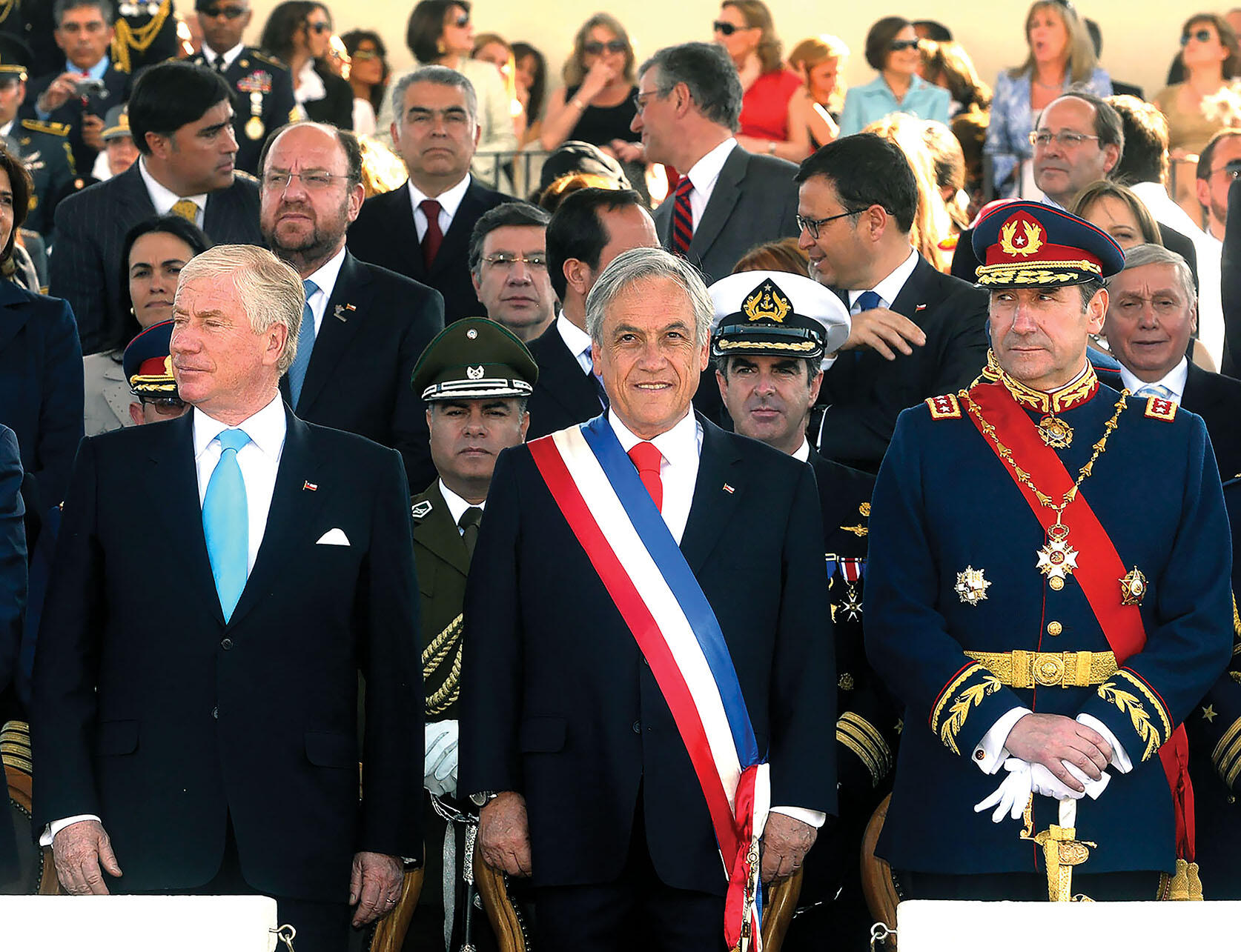 President Sebastián Piñera surrounded by military officers at a parade in 2010. (Photo courtesy of Gobierno de Chile.)
