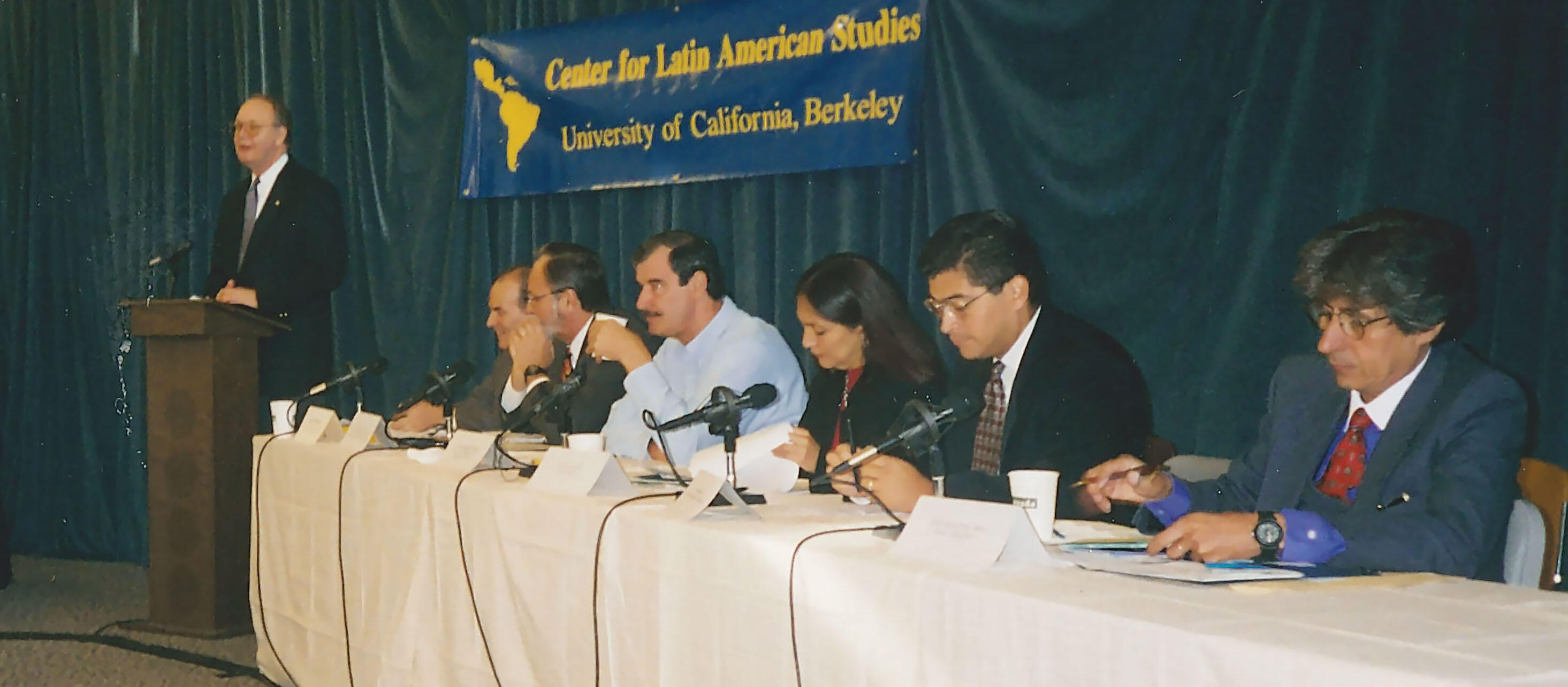 Harley Shaiken, David Bonior, Vicente Fox, Amalia García Medina, Xavier Becerra, and Adolfo Aguilar Zínser listen to UC Berkeley's Chancellor, Robert Berdahl, at the Alternatives for the Americas conference, 1998. (Photo by CLAS staff.)