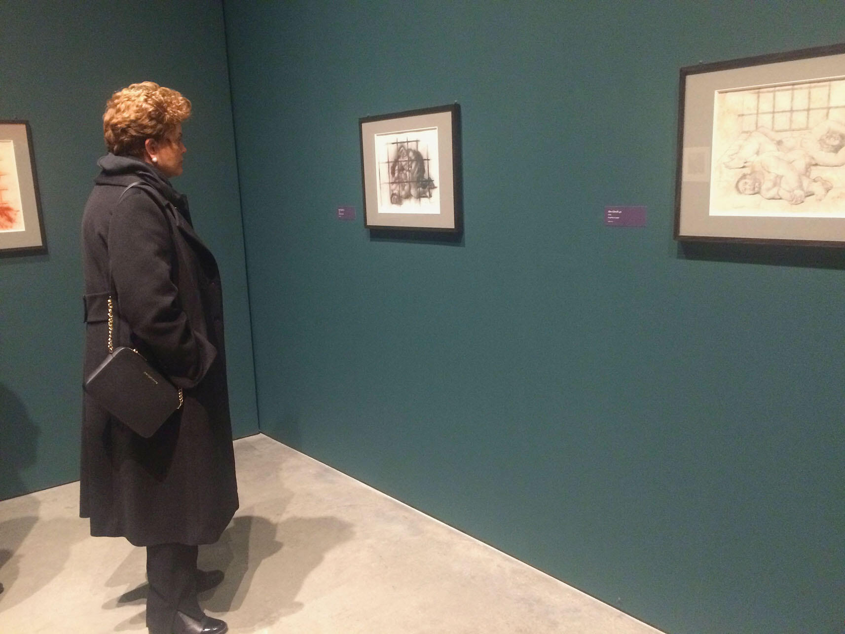 """Dilma Rousseff gazes at Botero's """"Abu Ghraib 17"""" in the Berkeley Art Museum. (Photo by Isabel Nogueira.)"""