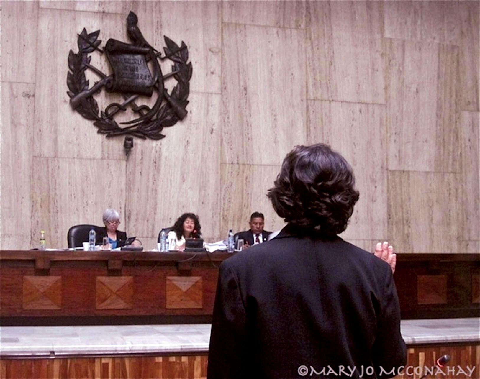 Beatriz Manz is sworn in at the Ríos Montt trial in front of (from left) Justices Patricia Bustamante, Yassmin Barrios, and Pablo Xitumul. (Photo by Mary Jo McConahay.)