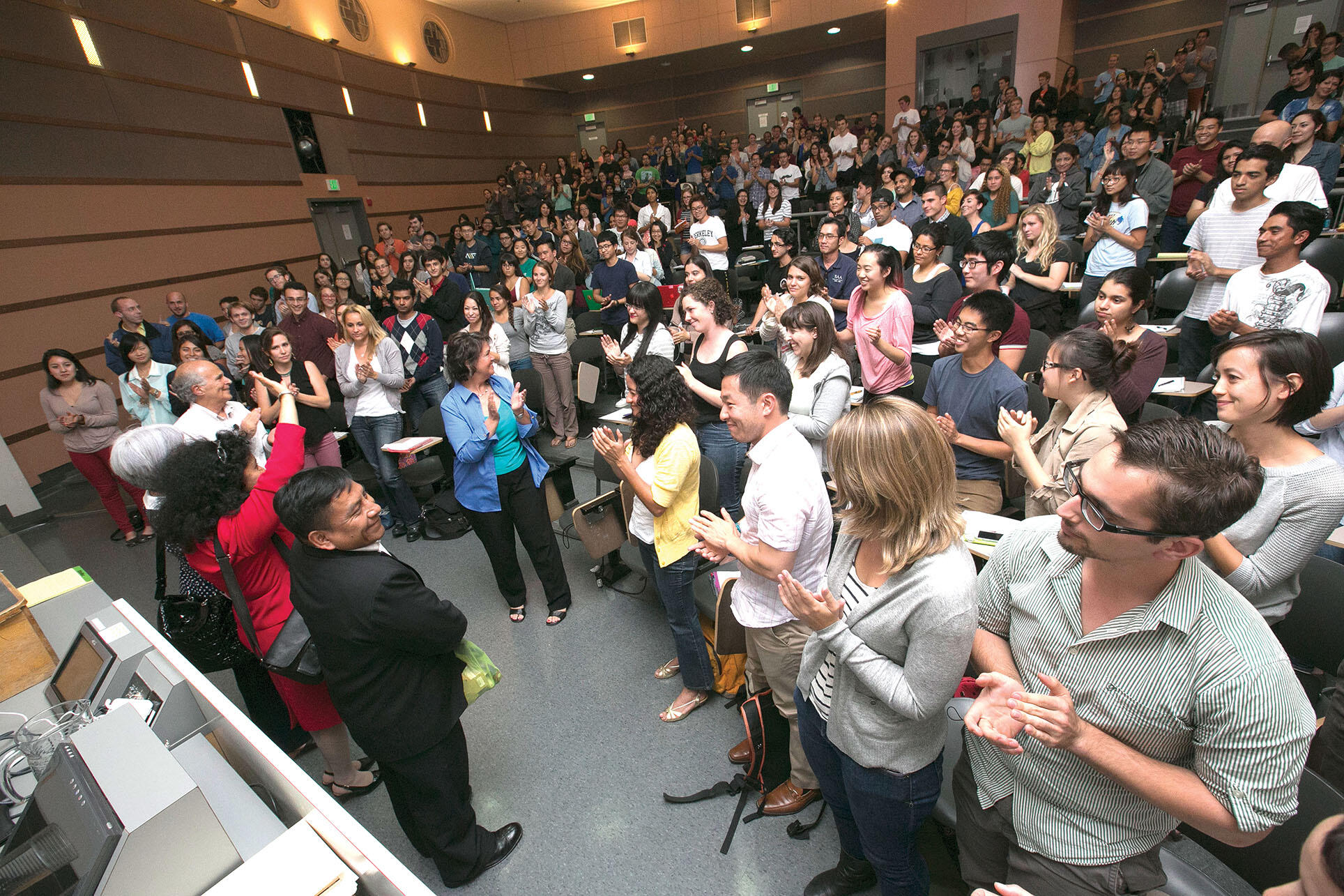 """UC Berkeley students in """"The Southern Border"""" course offer a standing ovation to the judges during their campus visit. (Photo by Jim Block.)"""