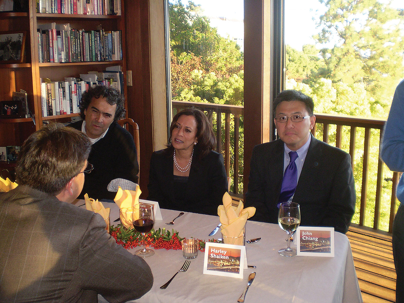Sergio Fajardo, Kamala Harris, and John Chiang speak over dinner with Pete Gallego (back to camera). (Photo by Meredith Perry.)