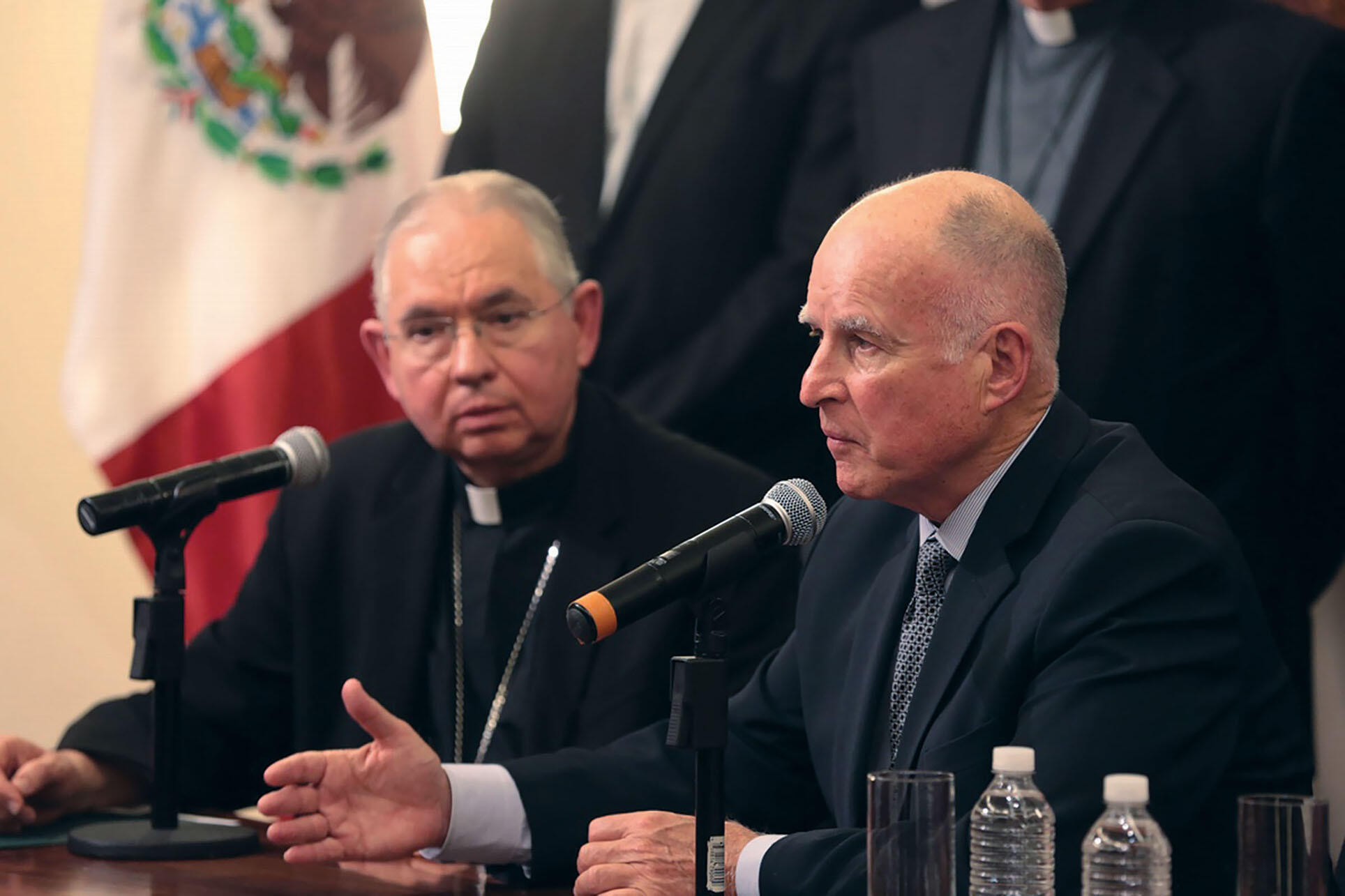 Governor Jerry Brown and Archbishop José Gómez at a Mexico press conference on unaccompanied minors at the U.S. border, July 2014. (Photo by Justin Short, Office of the Governor of California.) Governor Jerry Brown and Archbishop José Gómez at a Mexico pr
