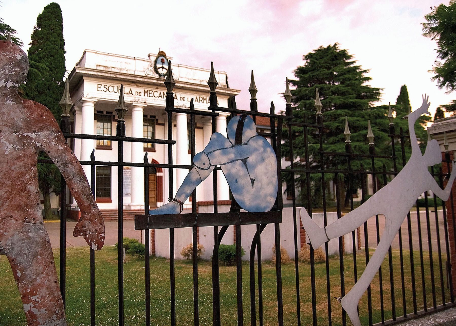 Metal figures welded to a fence form a memorial to torture victims in front of Argentina's Escuela de Mecánica de la Armada (ESMA). (Photo by David A. Wilbanks.)