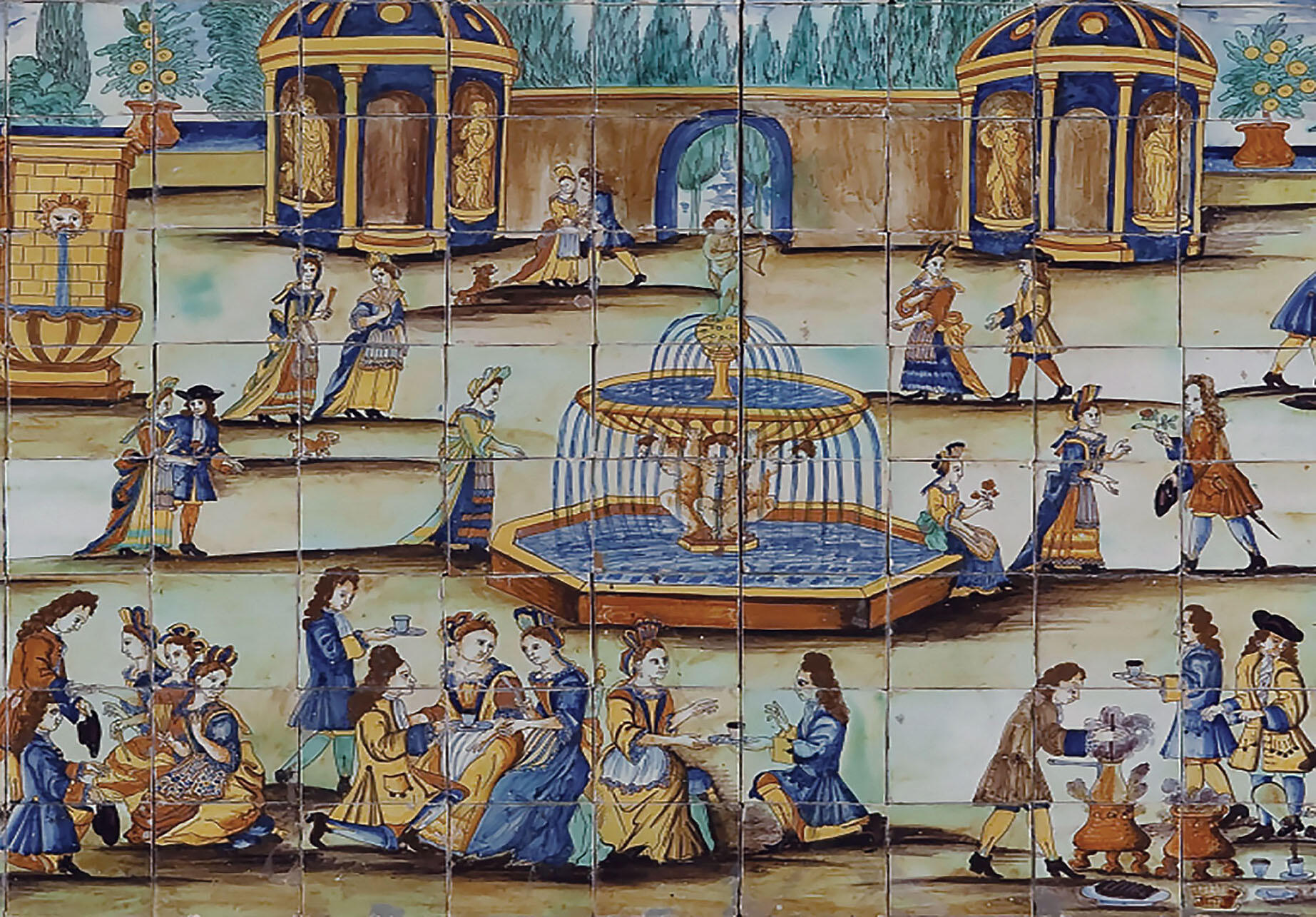 Painted blue and white tiles show scenes of chocolate drinking in Spain in the early 18th century. (Photo courtesy of the Collection of the Museo de Cerámica de Barcelona, Museu del Disseny de Barcelona.)