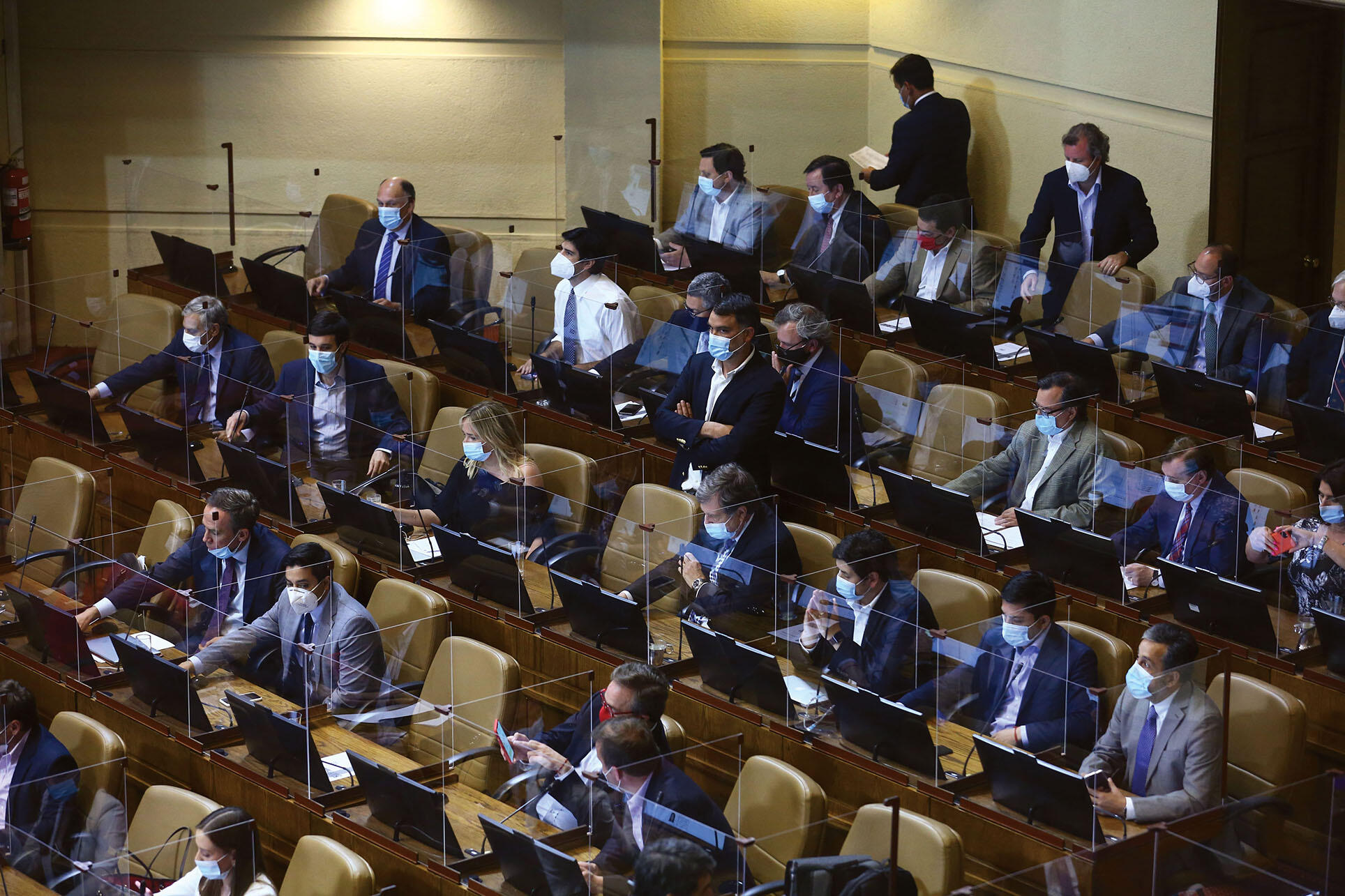 Members of Chile's Congress sit at their divided desks to discuss constitutional reform during the pandemic, November 2020. (Photo by Vivian Morales C.)
