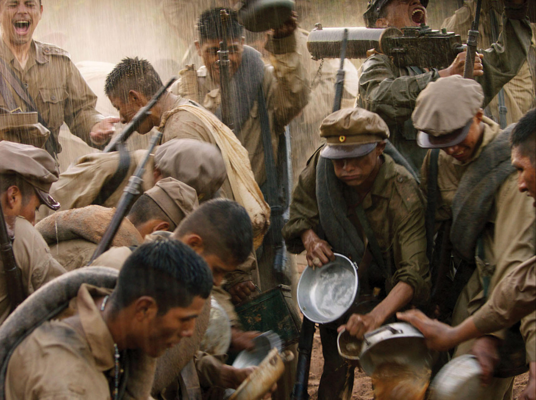 """A still from """"Chaco"""" shows soldiers' delirium and euphoria when it finally rains — no one knows how to quench their thirst. (Image courtesy of Color_Monster, Pasto, and Murillo Cine.)"""