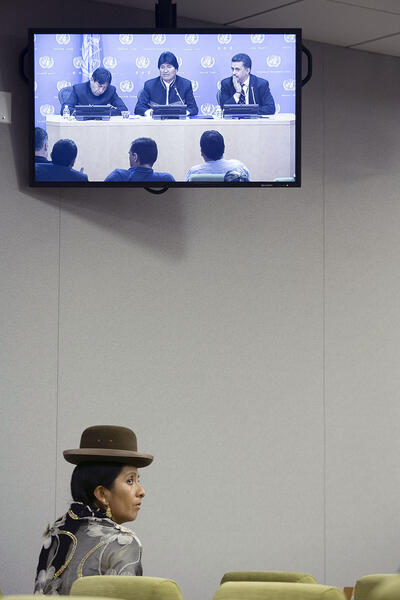 A woman in traditional Bolivian clothing watches Bolivian president Evo Morales at the United Nations. (Photo by Manuel Elia/UN Photo.)