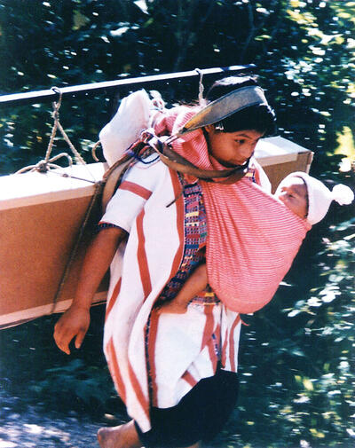 A Mayan woman carrying her child and a box of solar panels in Chiapas, Mexico. Stan ended all of his presentations with this slide. (Photo courtesy of Stan Ovshinsky.)