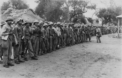 In a black and white photo from 1932, Paraguayan soldiers in Alihuatá, site of two major battles during the Chaco War. (Photo by Doctor Carlos De Sanctis/Wikimedia.)
