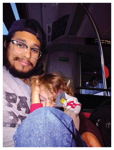 The author Everardo Reyes and his son riding the bus after Nahuatl class. (Photo by Everardo Reyes.)